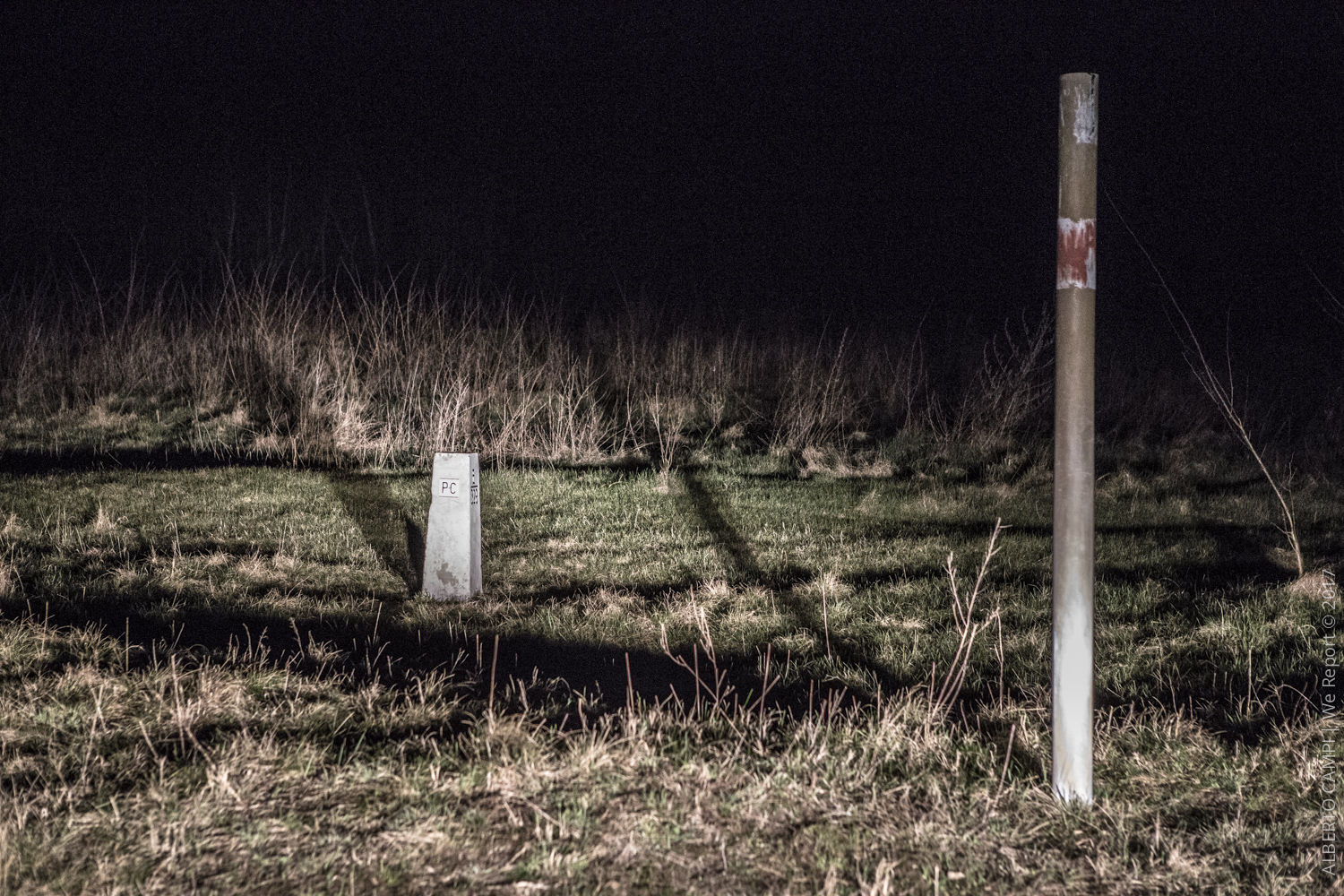 Boundary stone and pole marking the borderline. Subotica, Serbia, March 2015